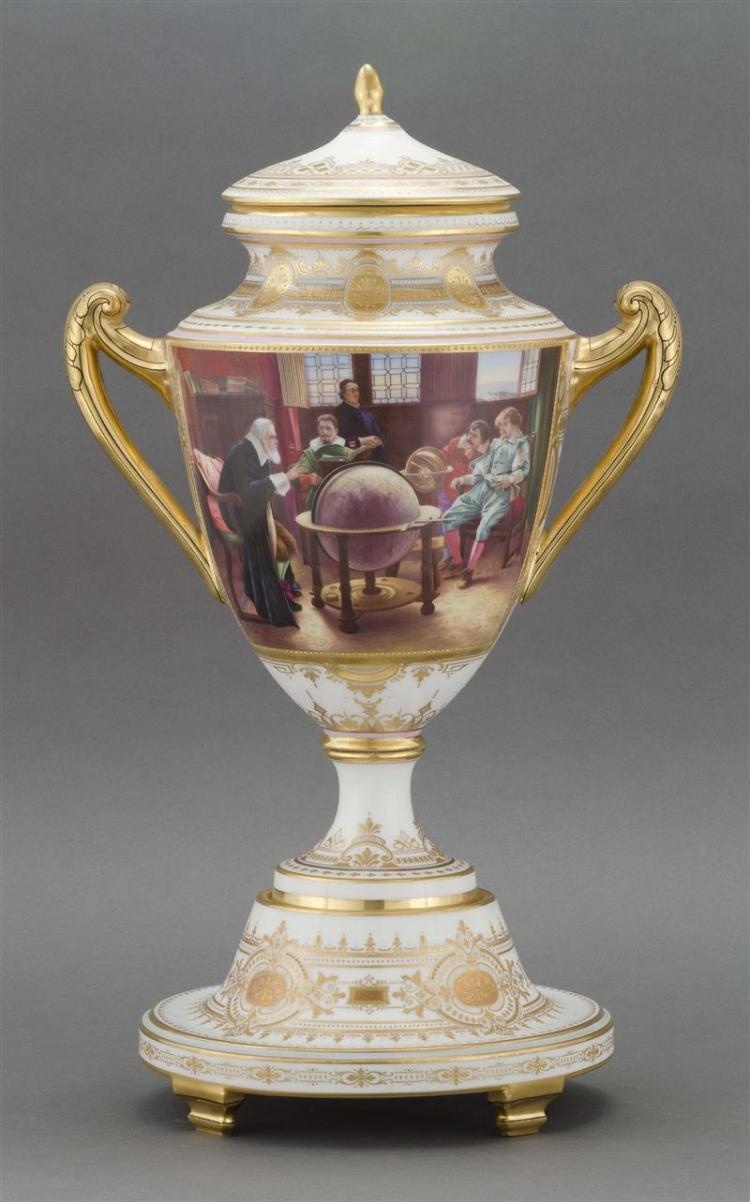 ROYAL VIENNA PORCELAIN COVERED URN Extensive gilt decoration on white porcelain. Hand-painted front panel depicts