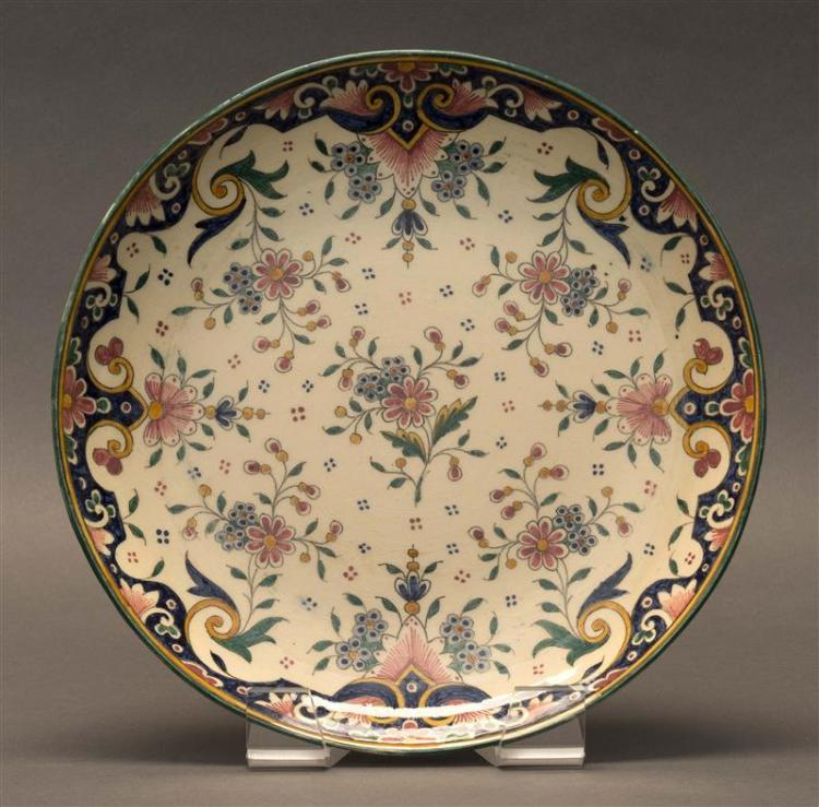 QUIMPER POTTERY PLATE In a floral design. Marked