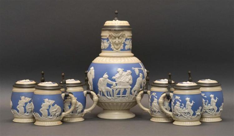 SEVEN-PIECE METTLACH/VILLEROY & BOCH STONEWARE STEIN SERVICE Each covered, pewter-mounted, and relief-decorated with male figures en...
