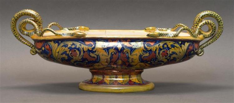 ITALIAN TIN-GLAZE FOOTED CENTER BOWL Slightly iridescent multicolor glaze with decoration of griffins and leaves. Entwined snake han...