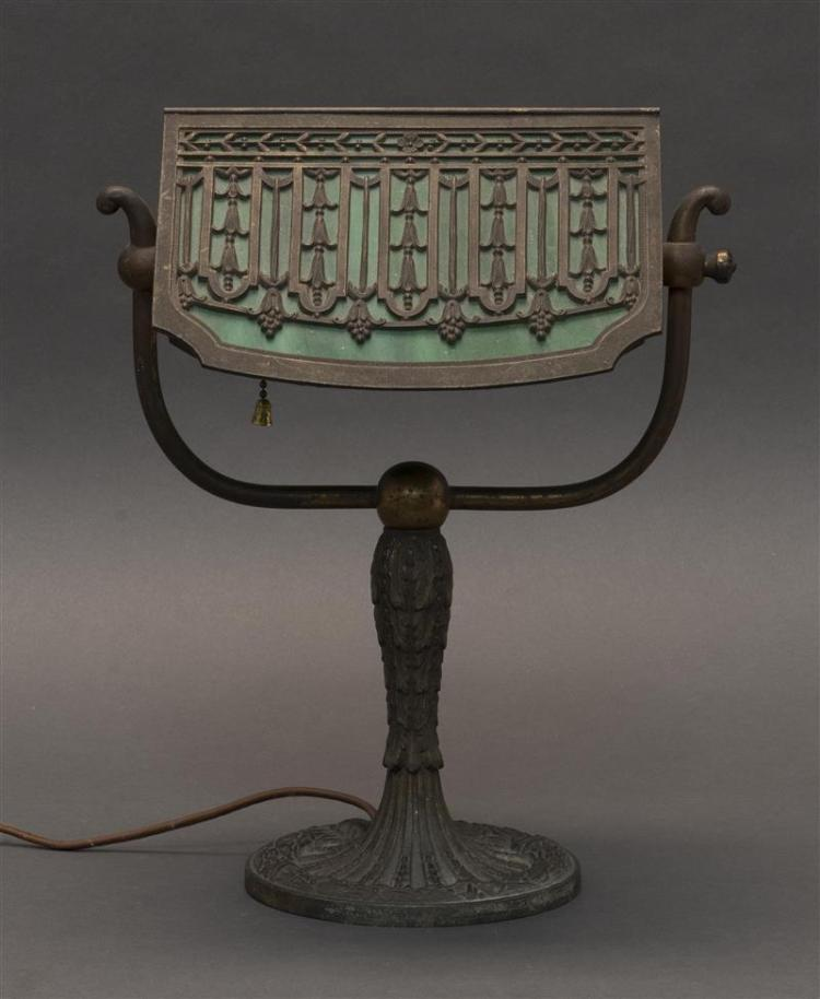 SLAG GLASS AND BRONZE STUDENT LAMP Adjustable shade with stylized foliage against a green glass ground. Unmarked. Height 12.5