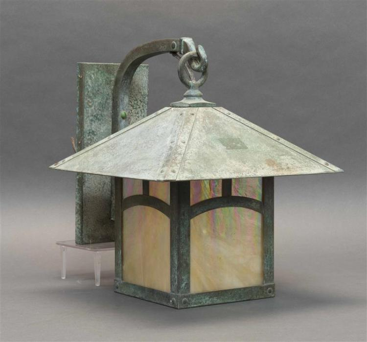 MISSION-STYLE COPPER AND SLAG GLASS LANTERN-FORM SCONCE Formed as a lantern with peaked roof. Mounted to a bracket. Label for Arroyo...