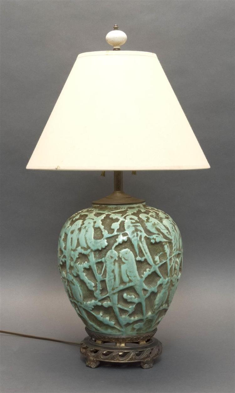 ART DECO-STYLE PORCELAIN TABLE LAMP Relief-decorated with pairs of parakeets. Mounted to a pierced metal base. Height to top of porc...