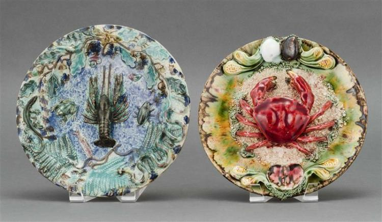 TWO MAJOLICA PALISSY-STYLE PLATES One with high-relief crab decoration surrounded by seaweed and mollusks. The other with central cr...