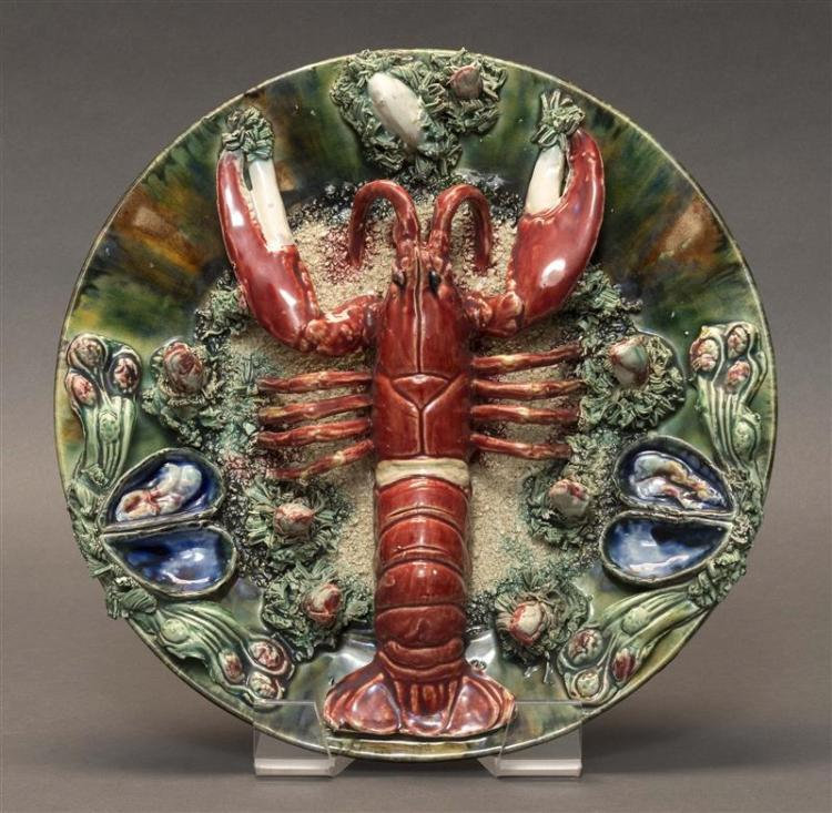 PALISSY-STYLE MAJOLICA CHARGER Decorated with a lobster, mussels, and applied encrustation. Indistinct impressed mark on reverse. Di...