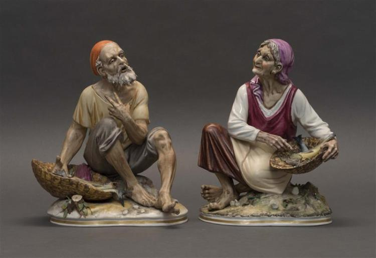 PAIR OF PM&M PORCELAIN FIGURES Modeled as a male and female fishmonger. Factory marks. Heights 10