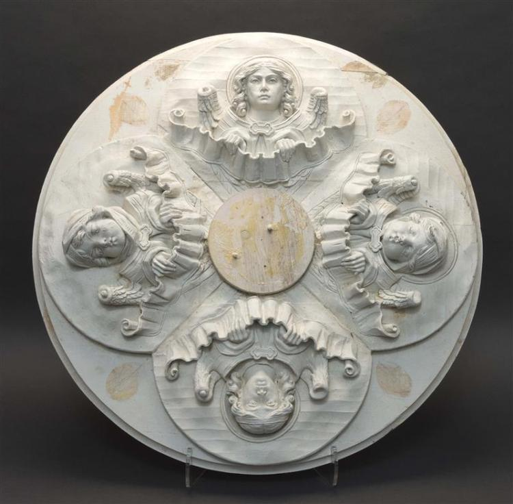 WOOD AND PLASTER CEILING MEDALLION ATTRIBUTED TO IRVING & CASSON/A.H. DAVENPORT & CO. Modeled with four angel's heads. Unmarked. Dia..