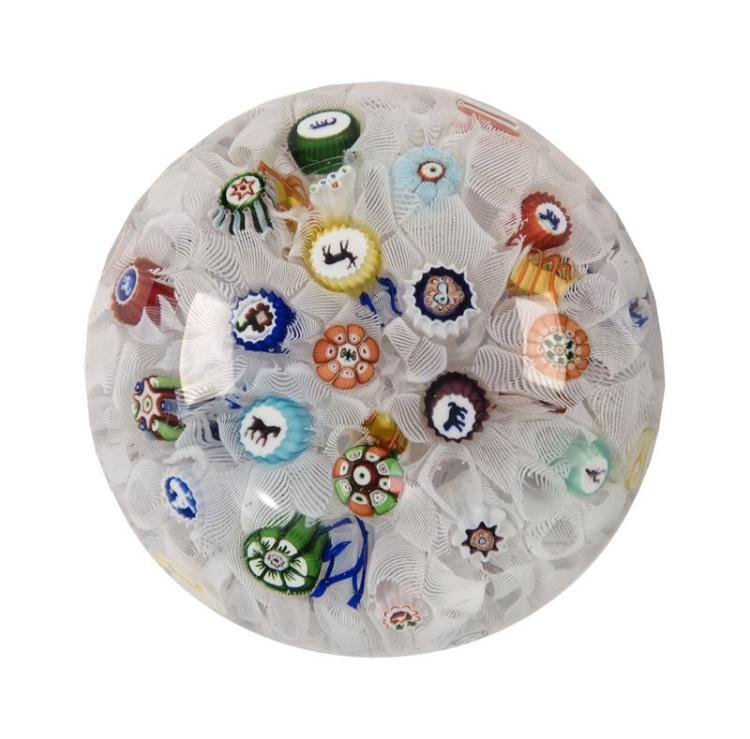 BACCARAT PAPERWEIGHT Numerous canes of varied animals atop a broken white cane ground. Signed with cane at one side