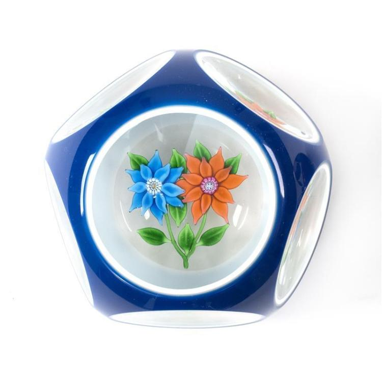 ST. LOUIS DOUBLE-CUT OVERLAY PAPERWEIGHT Opaque blue cut-to-white cut-to-clear. Blue and red poinsettia with green leaves. Center of...