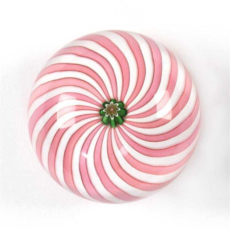 CLICHY PAPERWEIGHT Clichy rose in center cane on a swirled pink and white ground. Diameter 2.625