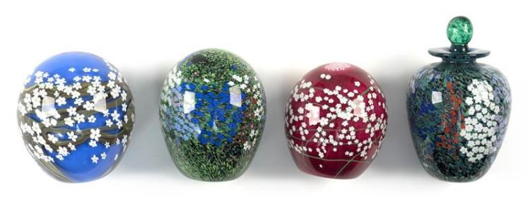 FOUR CONTEMPORARY GLASS PAPERWEIGHTS BY PETER RAOS All in floral designs with one in the form of a cologne bottle. All are signed