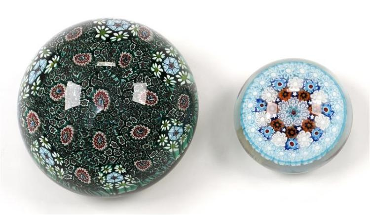 TWO MURANO GLASS PAPERWEIGHTS The smaller in cane design with concentric rings in colors of light and medium blue, white, and rust....