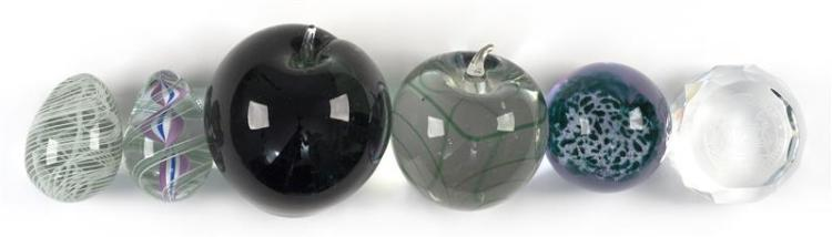 FOUR PAPERWEIGHTS TOGETHER WITH TWO GLASS EGGS Two are apple form, one abstract Caithness, and one faceted Massachusetts Institute o...