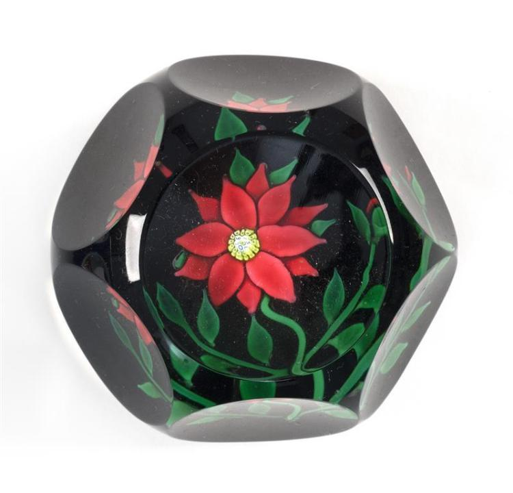 FACETED ST. LOUIS PAPERWEIGHT Red poinsettia design with green leaves. Signed in center blossom