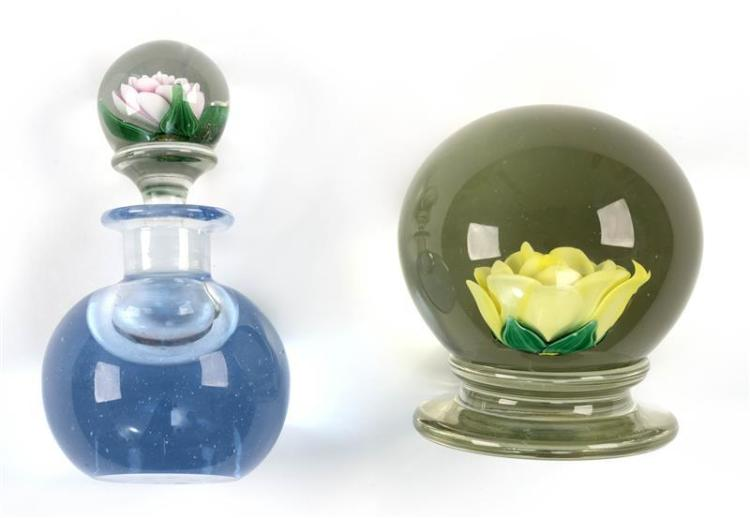 TWO GLASS ITEMS A pedestal paperweight with rose and green leaves.