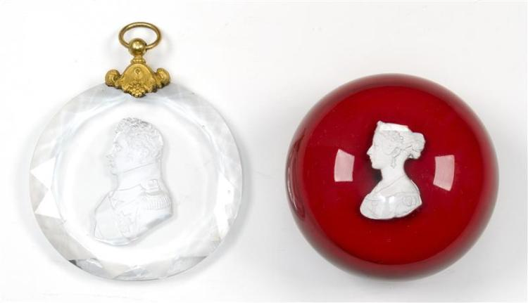 TWO SULFIDE ITEMS A paperweight attributed to Clichy depicts a bust of Queen Victoria. The other is a pendant that depicts a militar...