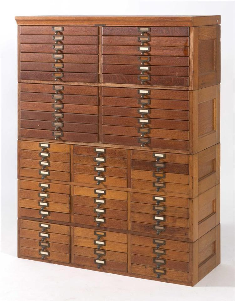 FOUR-SECTION COLLECTOR'S CABINET In oak with multiple drawers. Height 53¼