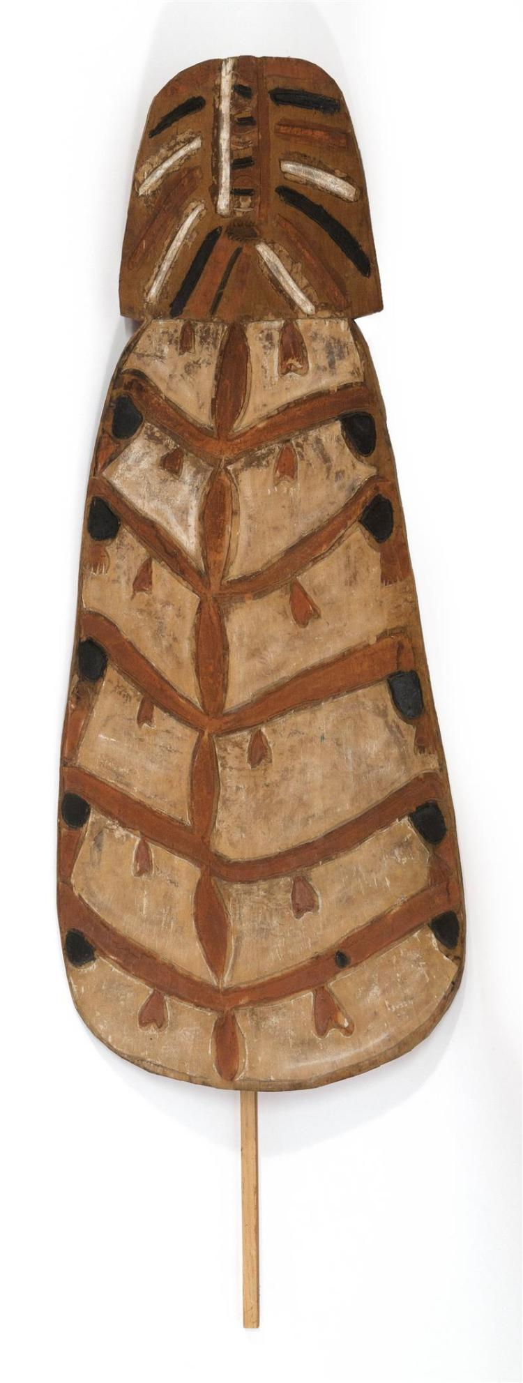 AFRICAN WOOD SHIELD With brown, black, and white tribal pattern. Length 64.5