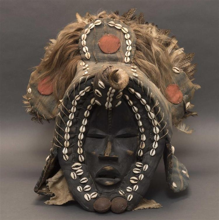 CÔTE D'IVOIRE HEADDRESS Made from wood, cloth, shell, horn, feathers, and fur. Height 17.5
