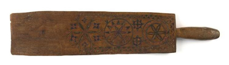 CARVED WOOD FOLK ART LAUNDRY PADDLE Most likely German. With incised polychrome geometric and pinwheel decoration on both sides. Rou...