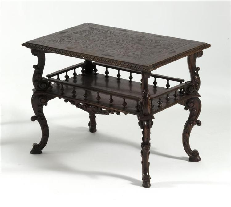 HORNER BROS. ELABORATELY CARVED OCCASIONAL TABLE Rectangular overhanging top with incised carving. Gallery shelf below. Fancy carved...
