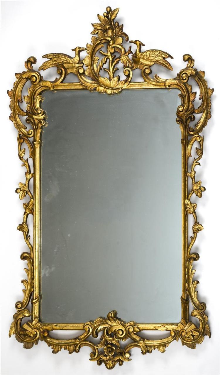 CHINESE CHIPPENDALE-STYLE CARVED GILTWOOD PIER MIRROR The reticulated frame decorated with scrolling foliage and two exotic birds pe...