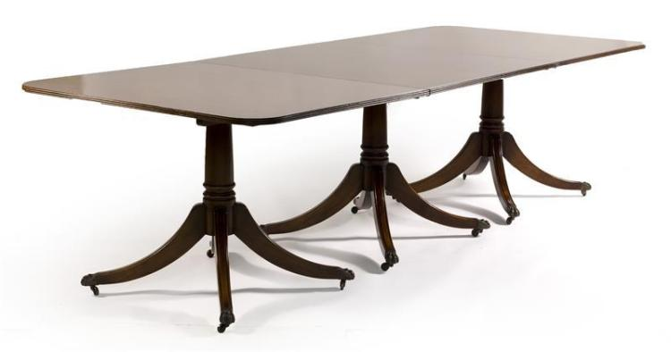 THOMAS GLENISTER GEORGIAN-STYLE THREE-PEDESTAL MAHOGANY EXTENSION DINING TABLE Top with reeded edge and two additional leaves. Each...