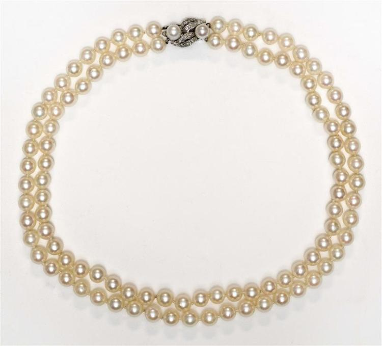 14KT WHITE GOLD AND PEARL DOUBLE STRAND NECKLACE With approximately 6 mm beads. Length 16.25