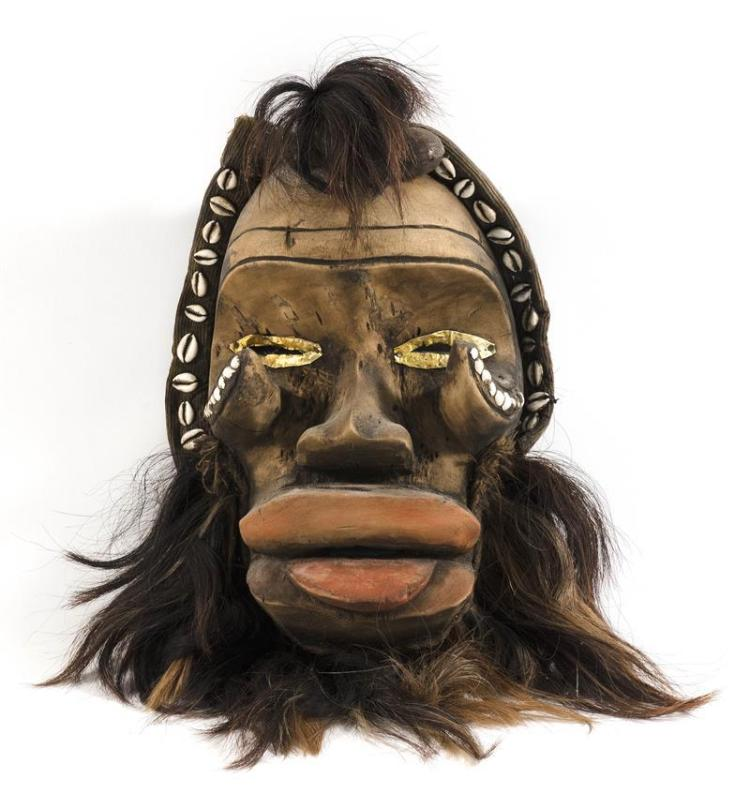 CÔTE D'IVOIRE HEADDRESS In wood, shell, fur, and salvaged metal. Height 17