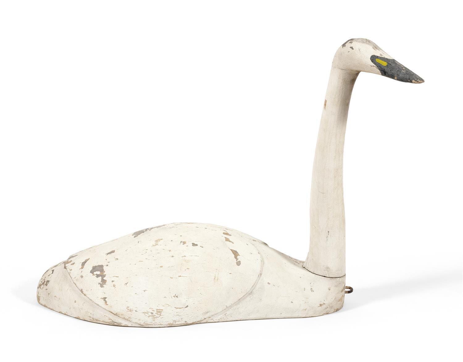 "LIFE-SIZE SWAN DECOY Maker unknown. Turned head. Carved ""turtle"" back. Height 24.5"". Length 38""."