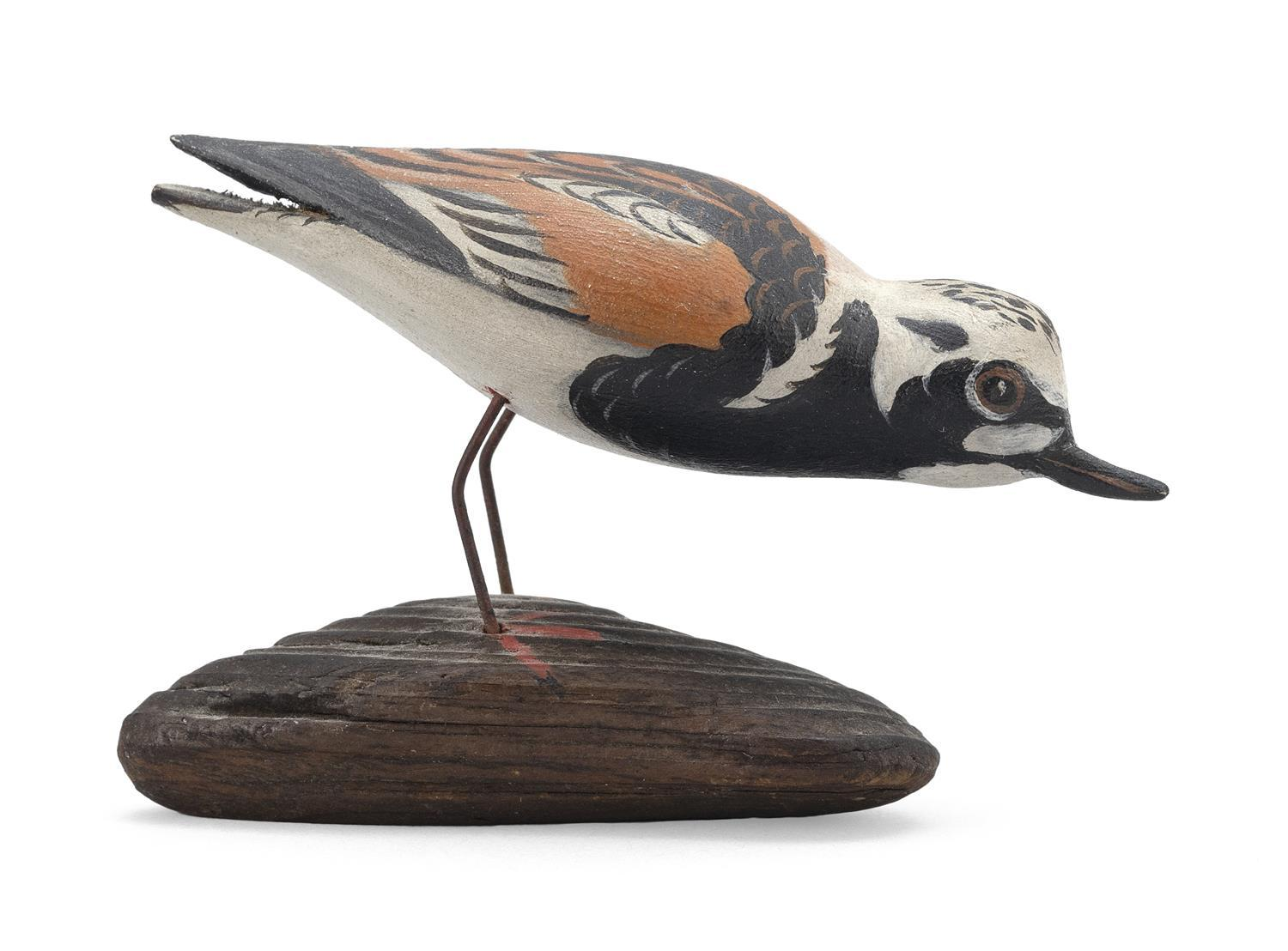 "A. ELMER CROWELL MINIATURE RUDDY TURNSTONE In feeding position. Mounted to a driftwood base. Unsigned. Length 3"". From the Mr. & Mrs..."