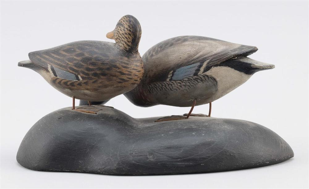 PAIR OF A. ELMER CROWELL MINIATURE MALLARDS Drake in feeding position and hen's head turned back toward her body. Mounted together o..