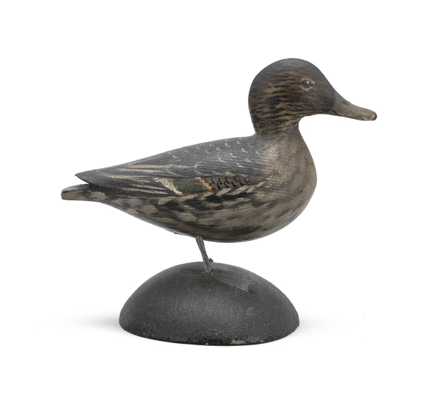 "A. ELMER CROWELL MINIATURE PINTAIL HEN Rectangular brand. Length 3.25"". From the Mr. & Mrs. Ken DeLong Collection of Bird Carvings."