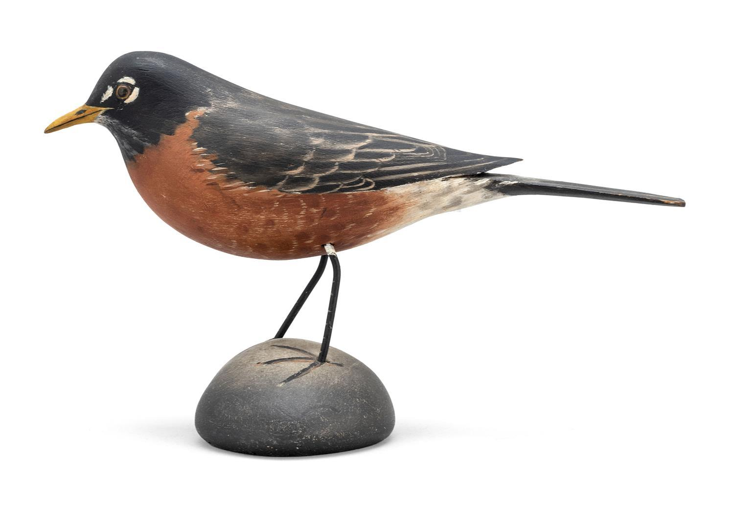 "A. ELMER CROWELL LIFE-SIZE ROBIN Unsigned. Height 5.75"". Length 8.75"". From the Mr. & Mrs. Ken DeLong Collection of Bird Carvings."