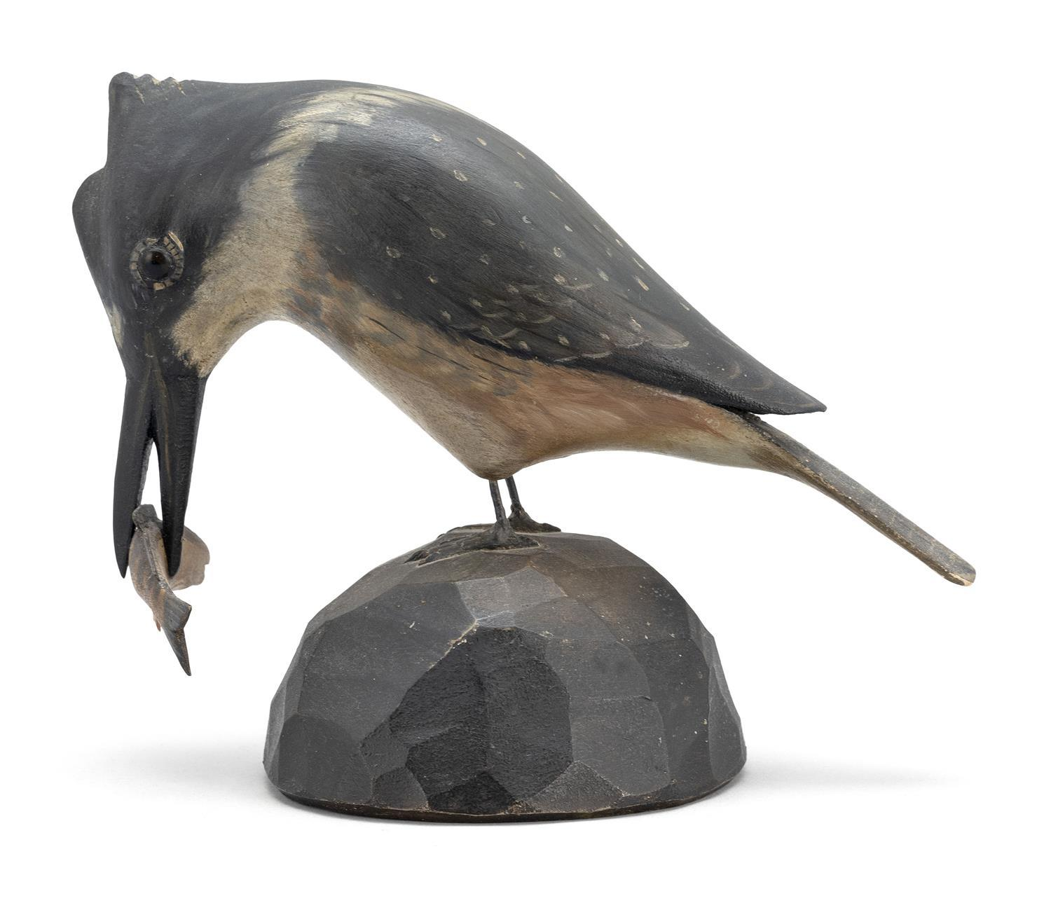 "A. ELMER CROWELL LIFE-SIZE KINGFISHER WITH A FISH IN ITS BILL Mounted on a chip-carved base. Rectangular brand. Height 5.75"". Length..."