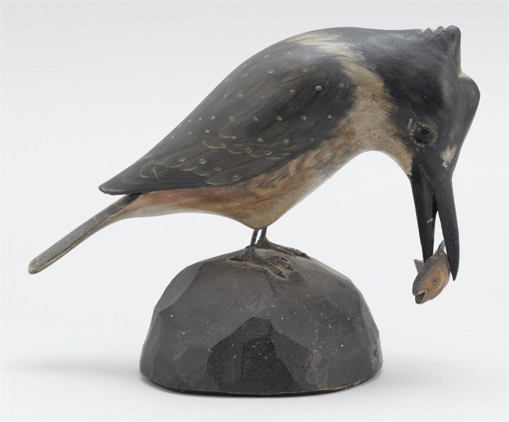 A. ELMER CROWELL LIFE-SIZE KINGFISHER WITH A FISH IN ITS BILL Mounted on a chip-carved base. Rectangular brand. Height 5.75