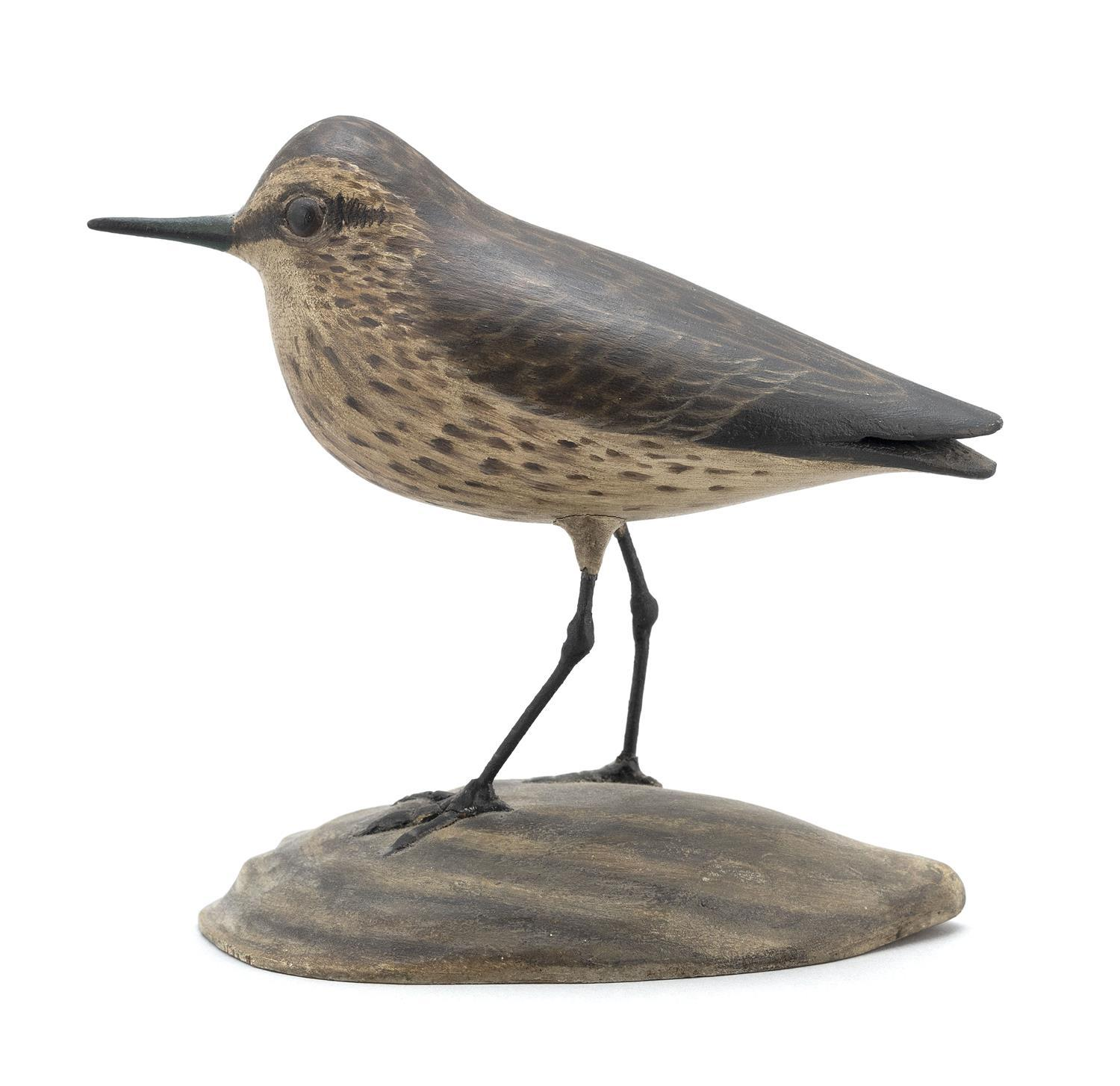 A. ELMER CROWELL LIFE-SIZE SANDPIPER MANTEL CARVING Glass eyes. Mounted on a sculpted oyster shell-form base. Rectangular brand. Hei...