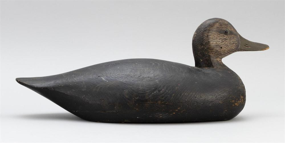 A. ELMER CROWELL BLACK DUCK DECOY Original paint. Glass eyes. Oval brand. Paint pattern on underside consistent with the decoy havin...