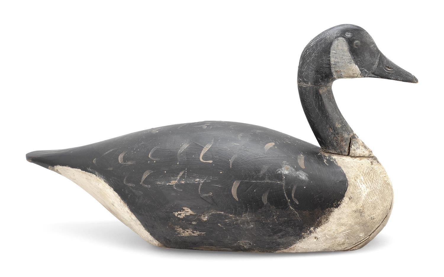 "A. ELMER CROWELL CANADA GOOSE DECOY Repainted. Oval brand. Rig brand on underside for ""D. Chase"". Length 23.5"". From the Mr. & Mrs...."