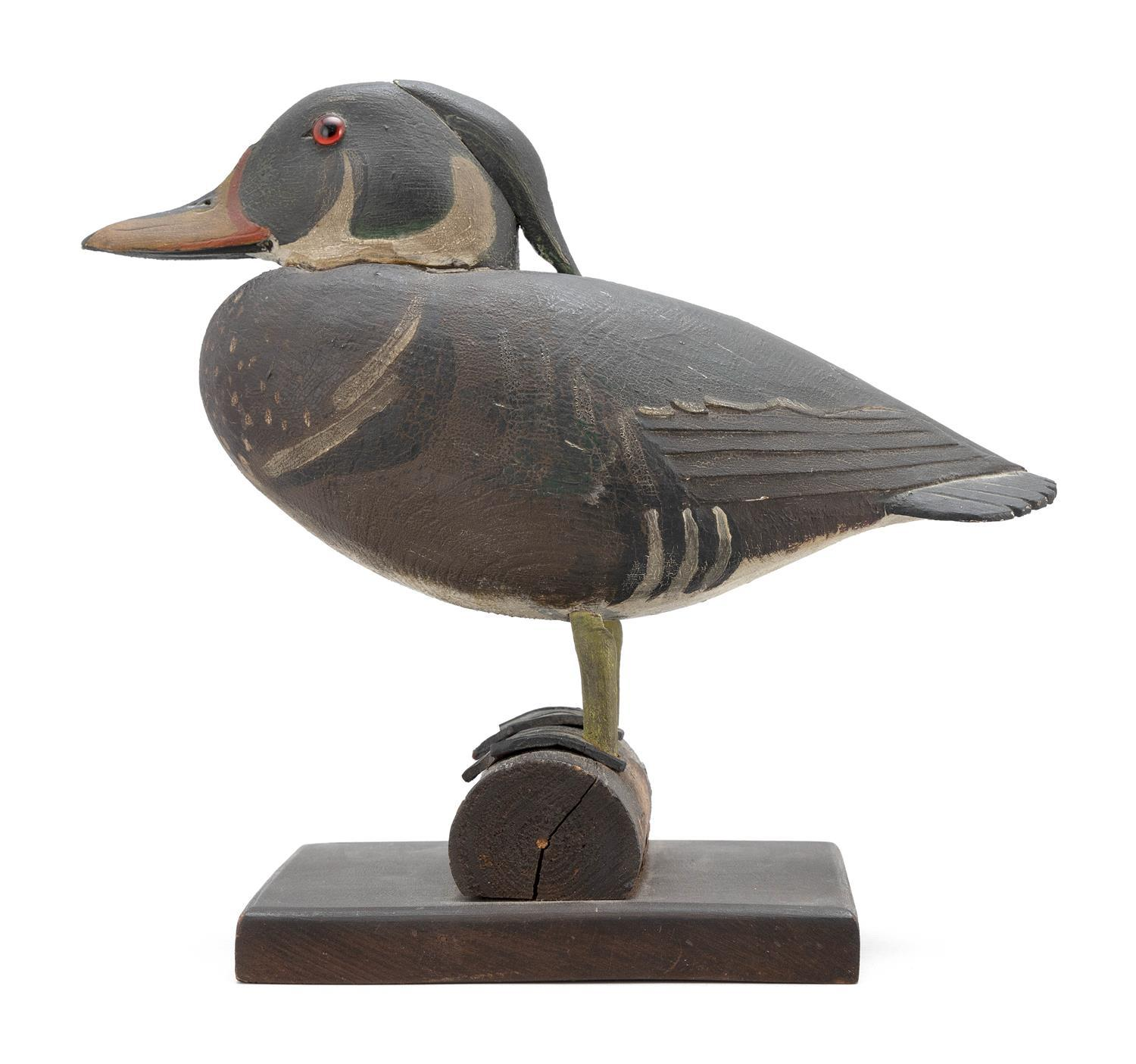 CHARLES HART DECORATIVE WOOD DUCK DRAKE Red glass eyes. Carved feathered details at wing tips and tail feathers. Superb patina. Heig...