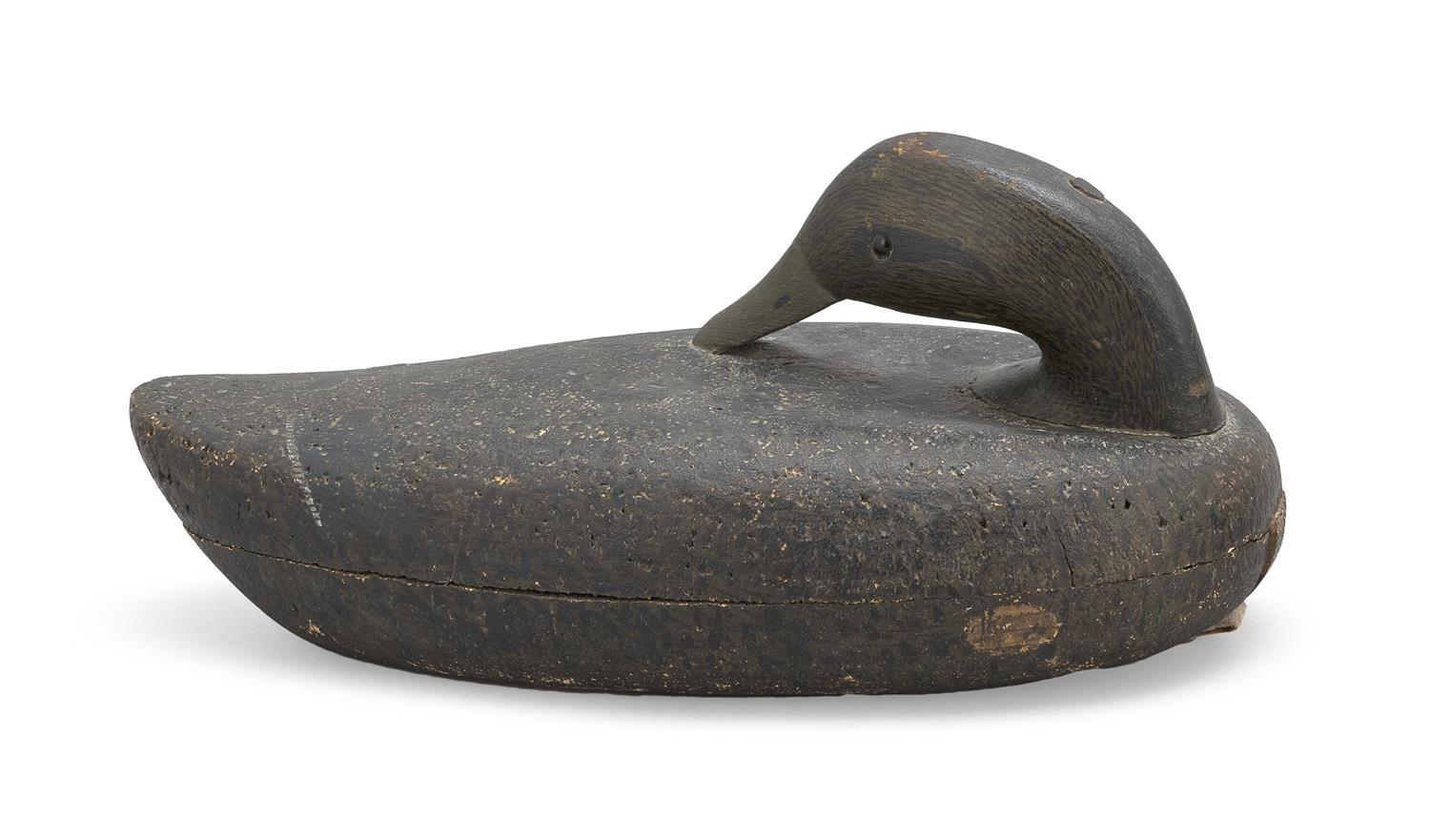 """GEORGE B. ROBERT CORK-BODIED BLACK DUCK DECOY In preening position. Rig brand on underside for """"Manning""""; tag identifies it as Willi..."""