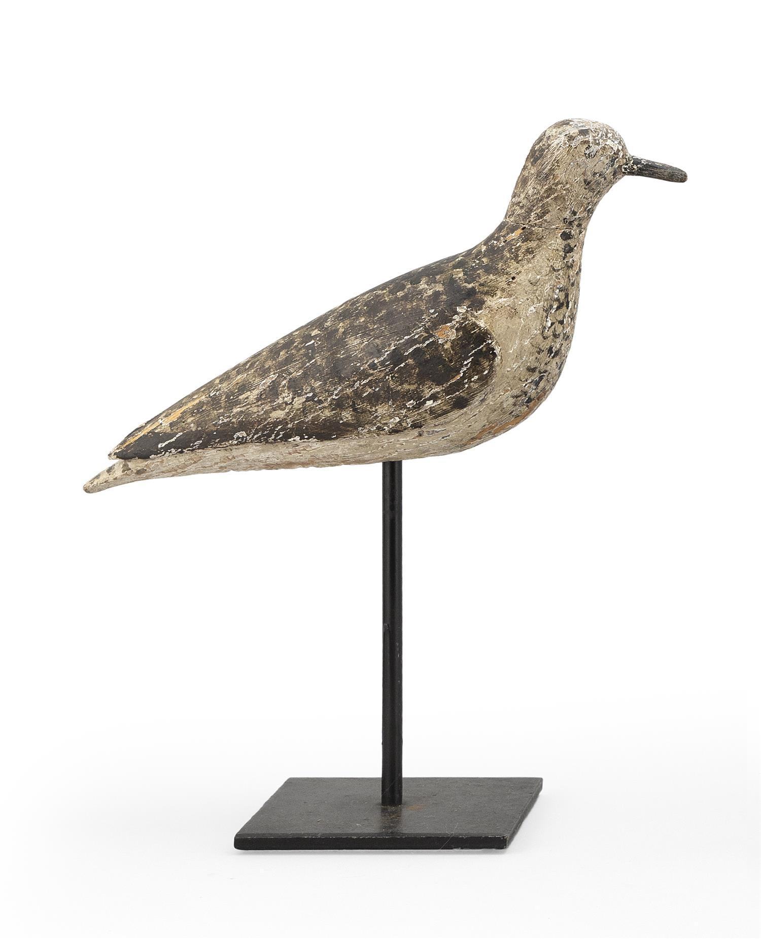 "MASSACHUSETTS GOLDEN PLOVER DECOY Maker unknown. Painted eyes. Carved wing detail. Length 11"". Ex-Collection: Hillman."