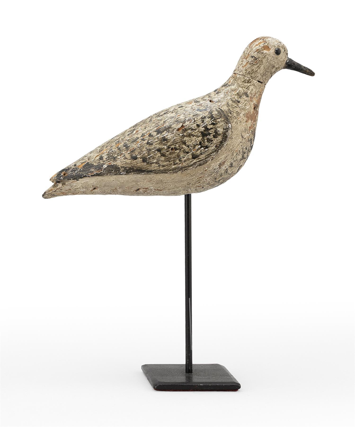 "MASSACHUSETTS GOLDEN PLOVER DECOY Glass eyes. Original paint with gunning wear. Carved wing detail. Length 11"". Ex-Collection: Hillman."