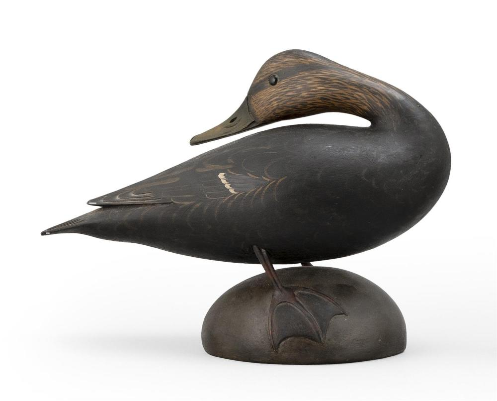 MARTY COLLINS CROWELL-STYLE BLACK DUCK DECOY In preening position. Glass eyes. Carved wing and tail feathers. Mounted on a round bas...