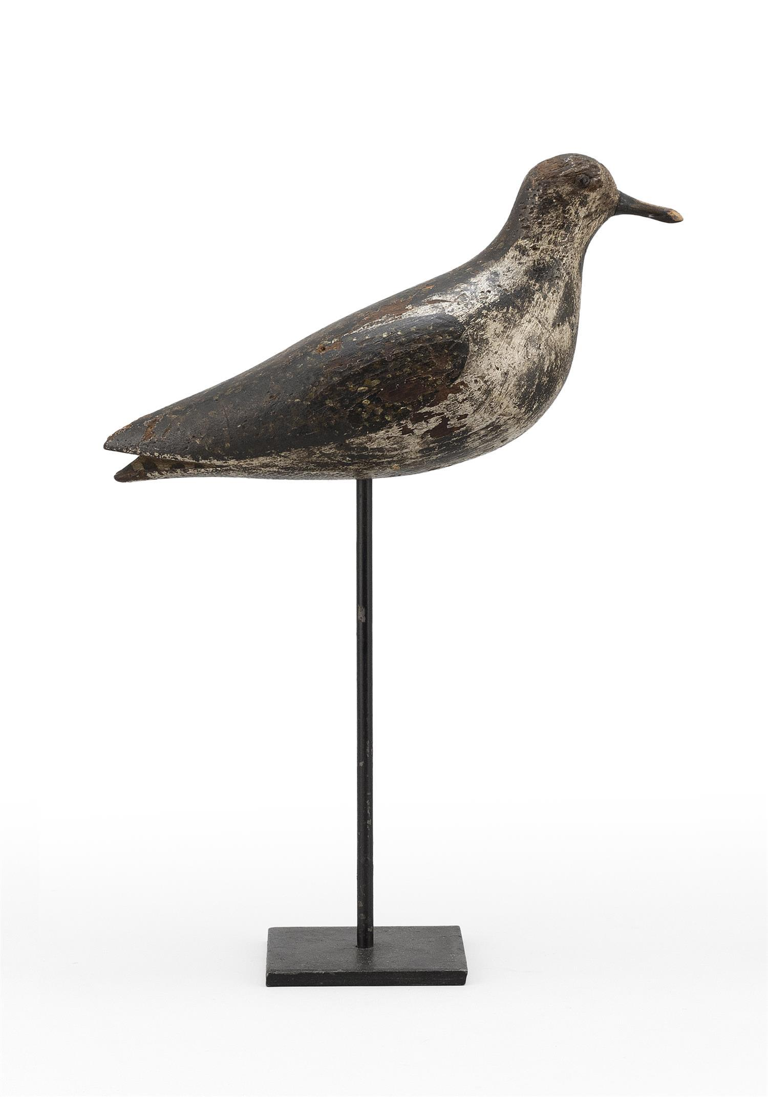 "MASSACHUSETTS GOLDEN PLOVER DECOY Maker unknown. Tack eyes. Original paint with considerable gunning wear. Length 10""."