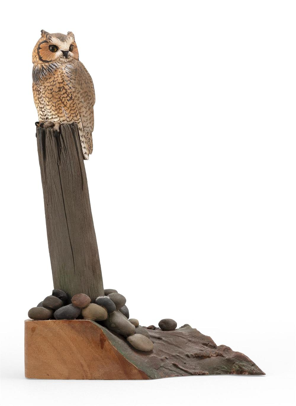 "AL JORDAN MINIATURE GREAT HORNED OWL Mounted on a wooden rockery-style base. Signed on lower right of base ""A Jordan"". Height 7""."