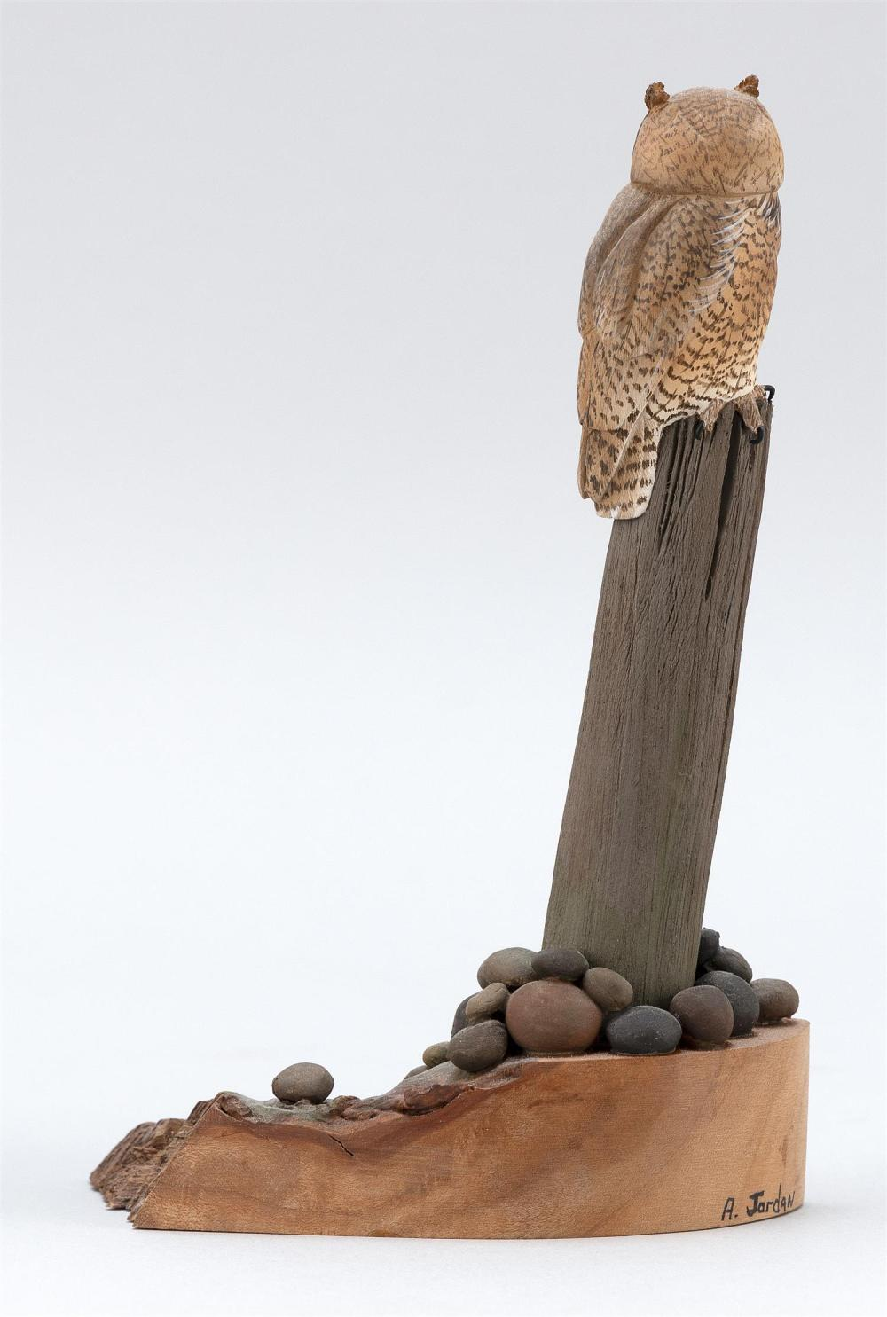 AL JORDAN MINIATURE GREAT HORNED OWL Mounted on a wooden rockery-style base. Signed on lower right of base
