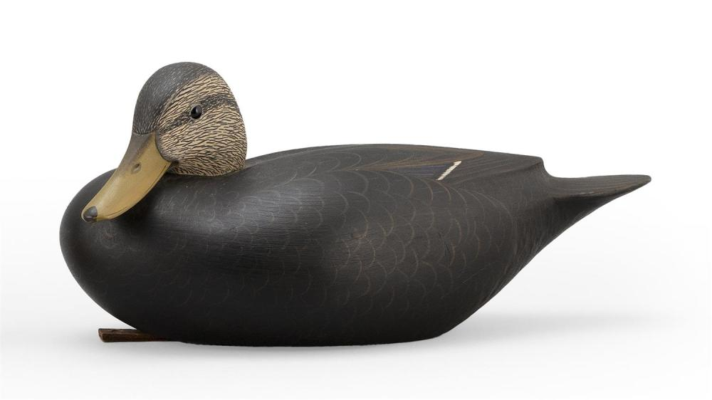 "MARTY COLLINS BLACK DUCK DECOY Hollow-carved. Head turned left. Glass eyes. Chip carving under tail. Branded on underside ""Martin D...."