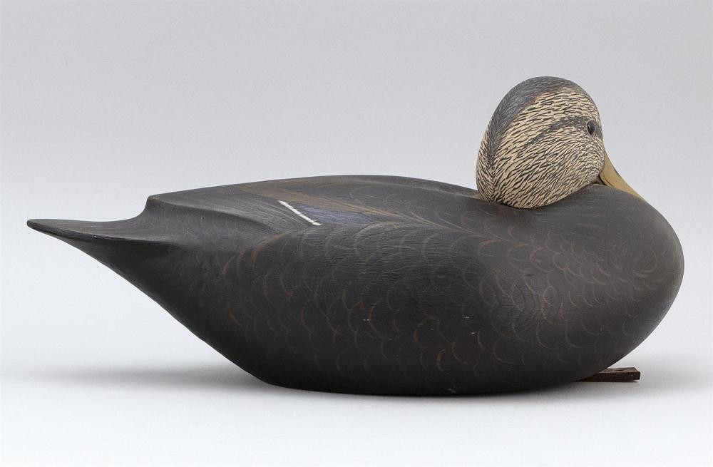 MARTY COLLINS BLACK DUCK DECOY Hollow-carved. Head turned left. Glass eyes. Chip carving under tail. Branded on underside