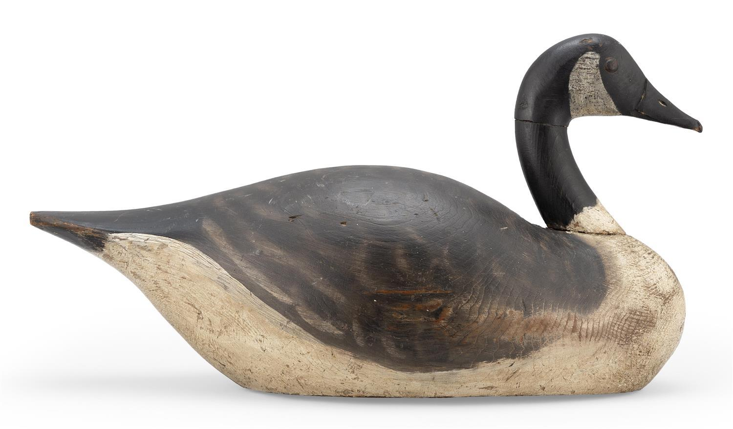 """A. ELMER CROWELL CANADA GOOSE DECOY Tack eyes. Original paint with traces of gunning repaint on white areas. Oval brand. Branded """"Q""""..."""
